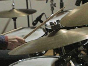 Playing music on drum set at Wellspring Sound Studio